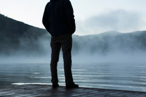 contemplate man on dock