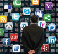 man standing in front of social media logos