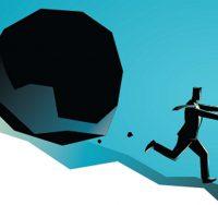 man running from boulder