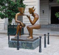 two statues talking